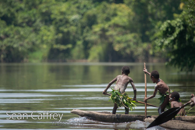 boys in a dug out canoe (Kombrob tribe)