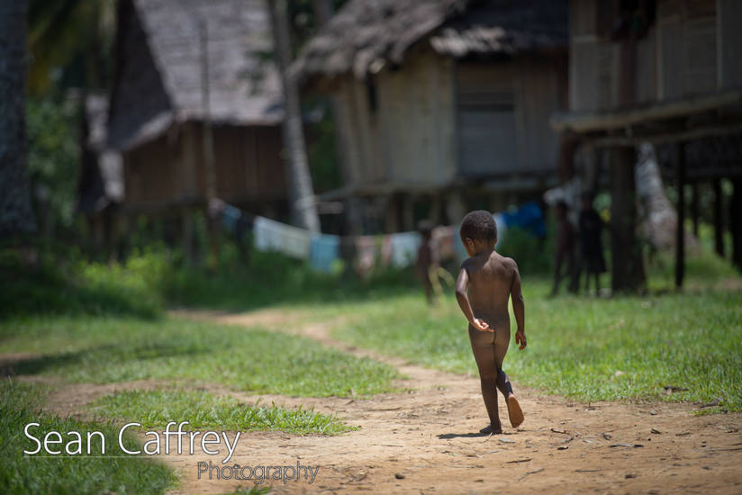 Boy walking in village